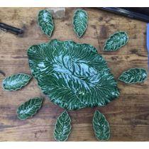 A 9-piece Portuguese, Bordalo leaf-moulded dish set