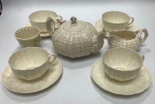 Eleven Belleek porcelain tea wares comprising four cups and saucers, a teapot, a milk jug and a