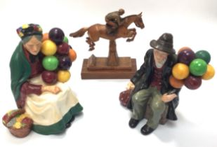 Two Royal Doulton figures 'The Old Balloon Seller' HN1315 together with 'The Balloon Man' HN1954 and