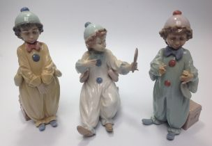 Three Lladro porcelain Clown / Pierrot figures including 'Pierrot in Preparation' No. 6257, 'Pierrot