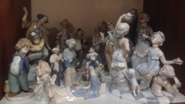 A 'Shudder' of Spanish porcelain clowns / pierrot including a large Casades figure group of three
