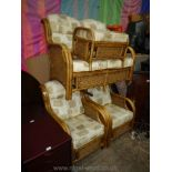A cane and rattan framed Conservatory Suite comprising a two-seater settee,