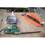 Bosch hedge cutter and extension leads.