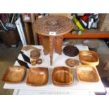 A small wooden folding table with a quantity of wooden bowls, coaster, napkin rings, etc.