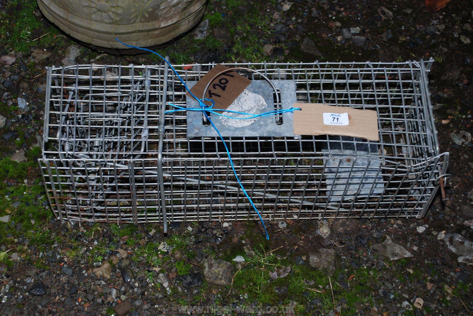A metal rat/animal trap.