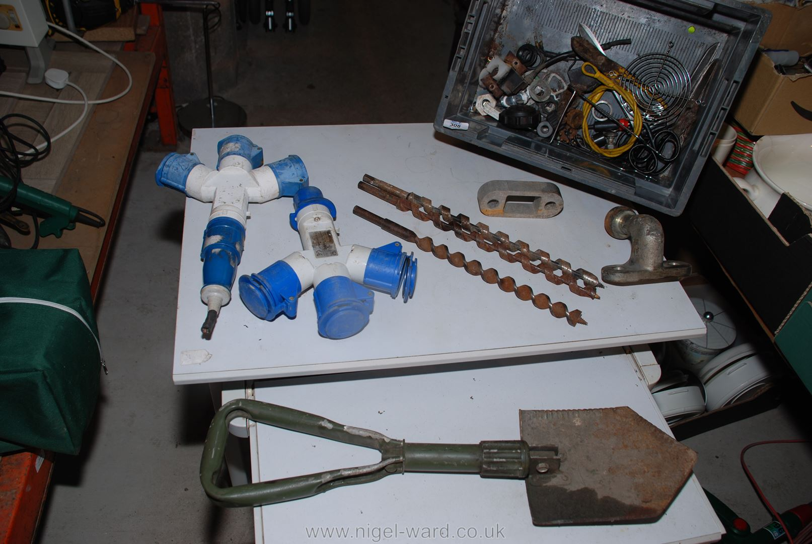 Various wooden drill bits, a tow hitch, folding military style shovel, 240 volt splitters, tools,