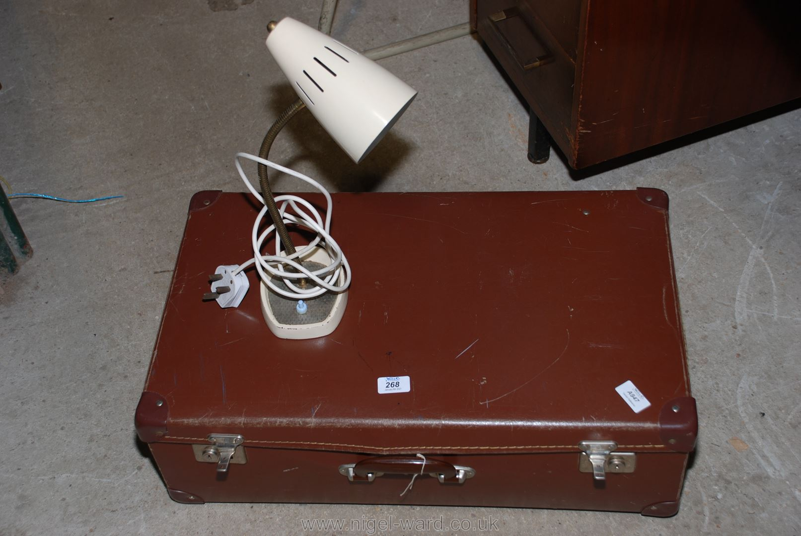 A suitcase and a desk lamp.