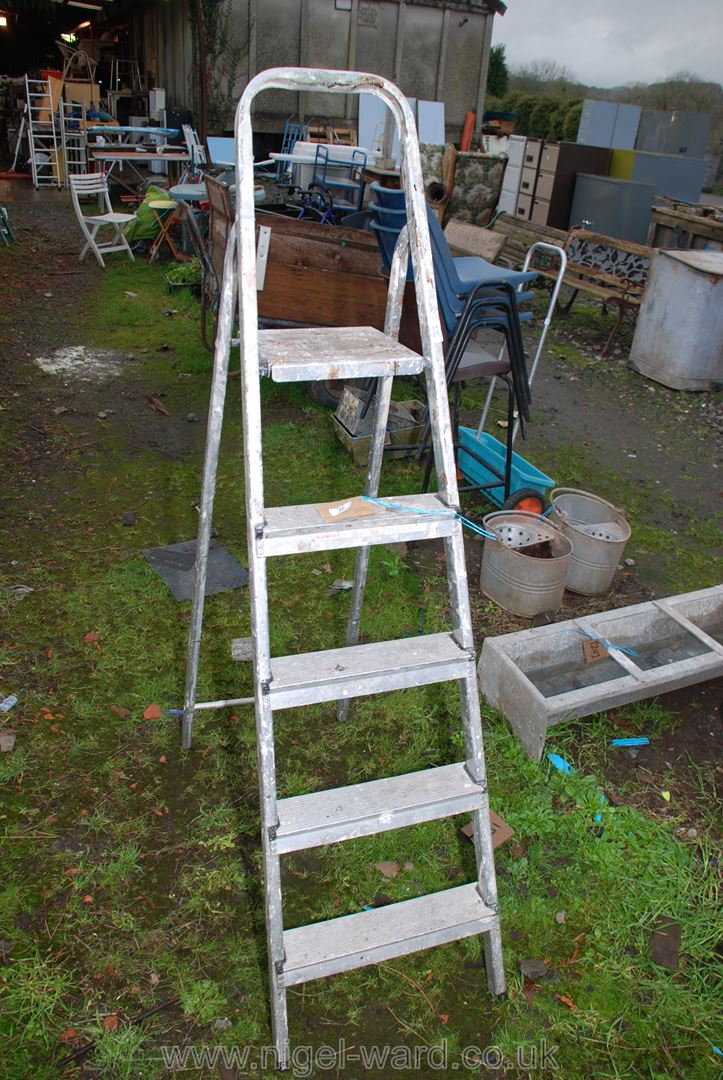 A four rung step ladder.