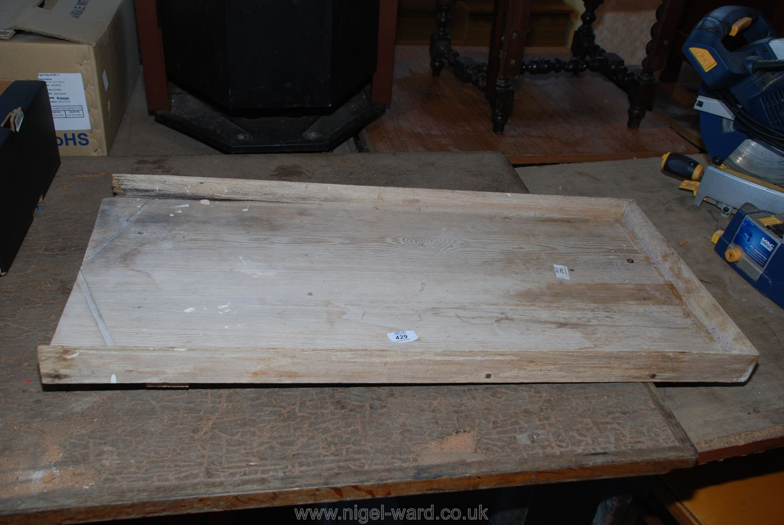 A Pine draining board, 36'' long x 17'' wide.