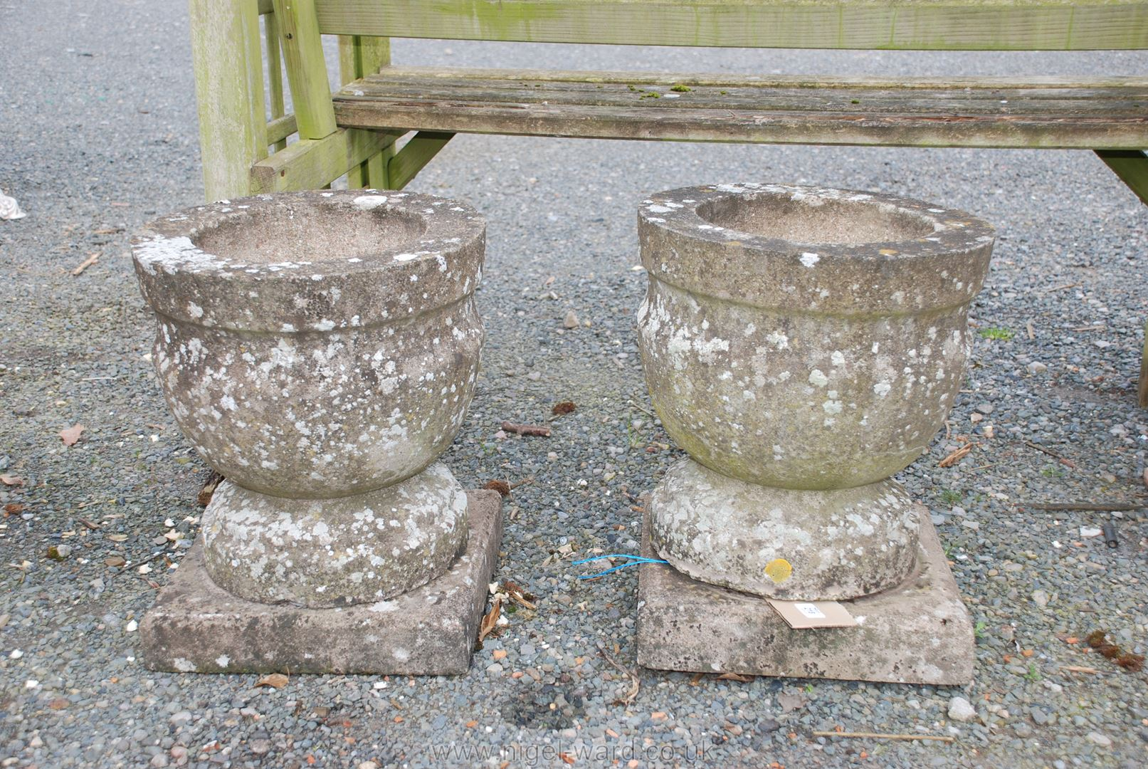 Pair of circular concrete planters on square bases, 18'' high x 15'' diameter,