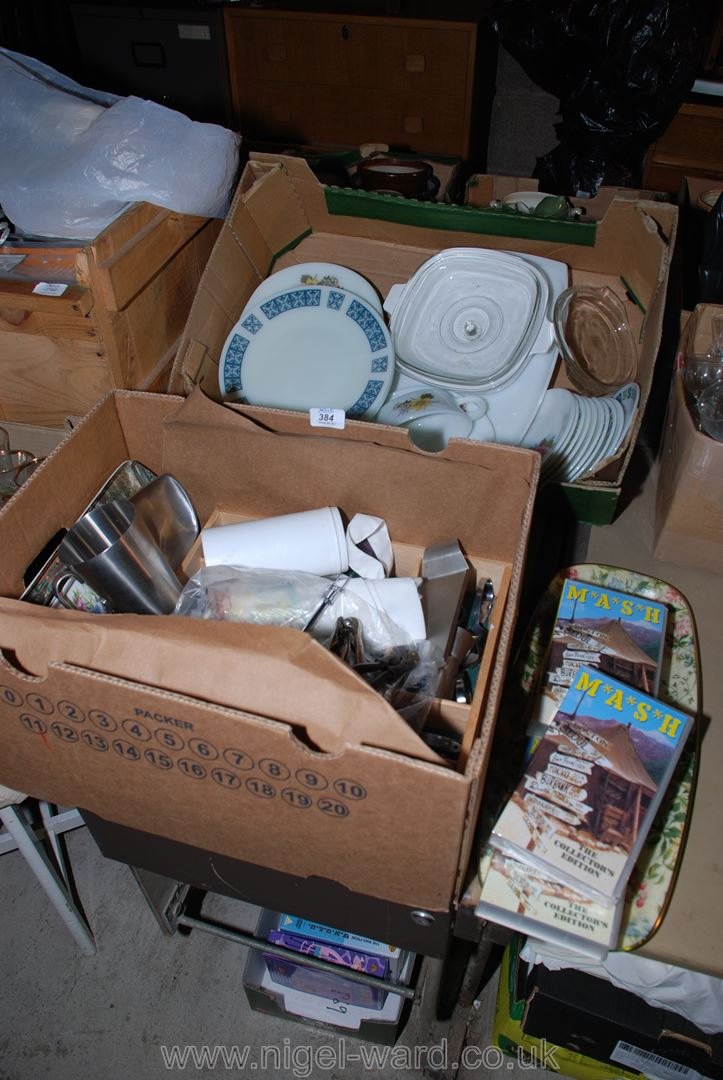 """A quantity of """"Pyrex"""" dinner plates, a cutlery tray and contents, nutcrackers, etc."""