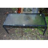 """A glass topped occasional table, 40"""" x 18"""" x 16"""" high."""