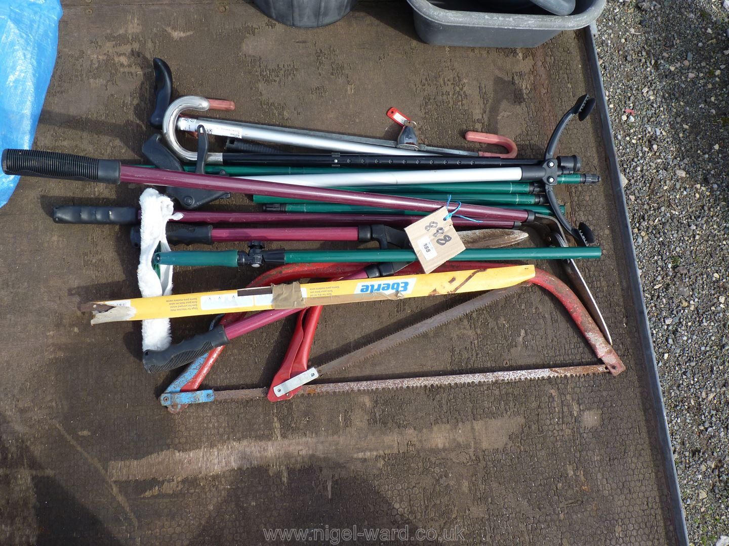 Quantity of bow saws, sticks, garden clippers, window washer,
