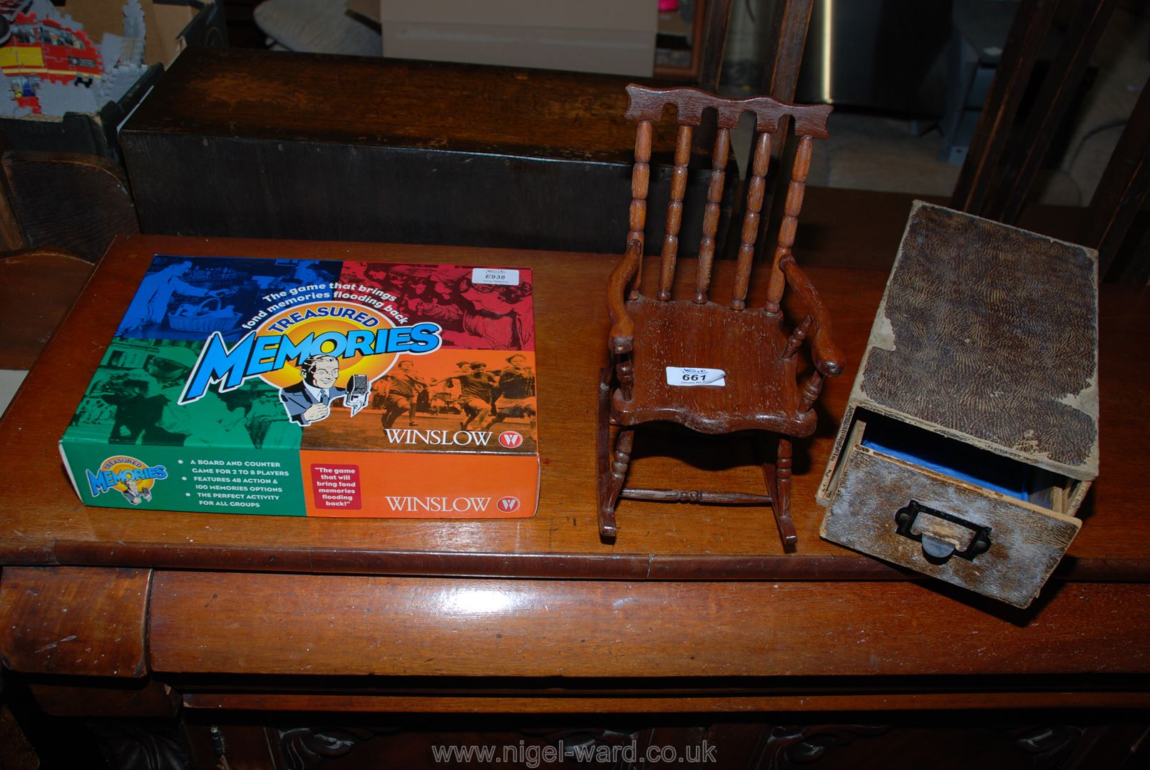 A miniature rocking chair, an index card box and a memories game.