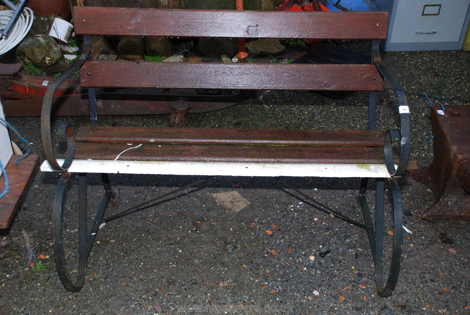 A metal framed garden bench.