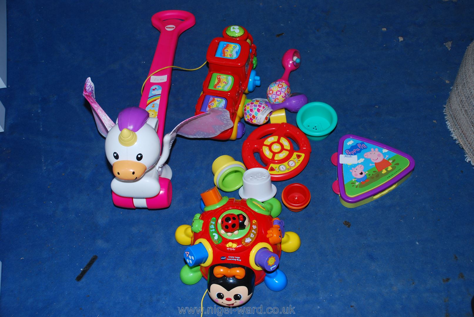 "A collection of children's toys including a ""Fisher-Price Push and Flutter Unicorn"","
