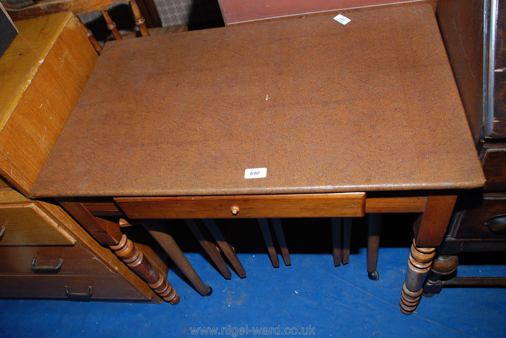 """A Pine writing table with covered top and standing on turned legs, 33"""" x 20"""" x 28"""" high."""