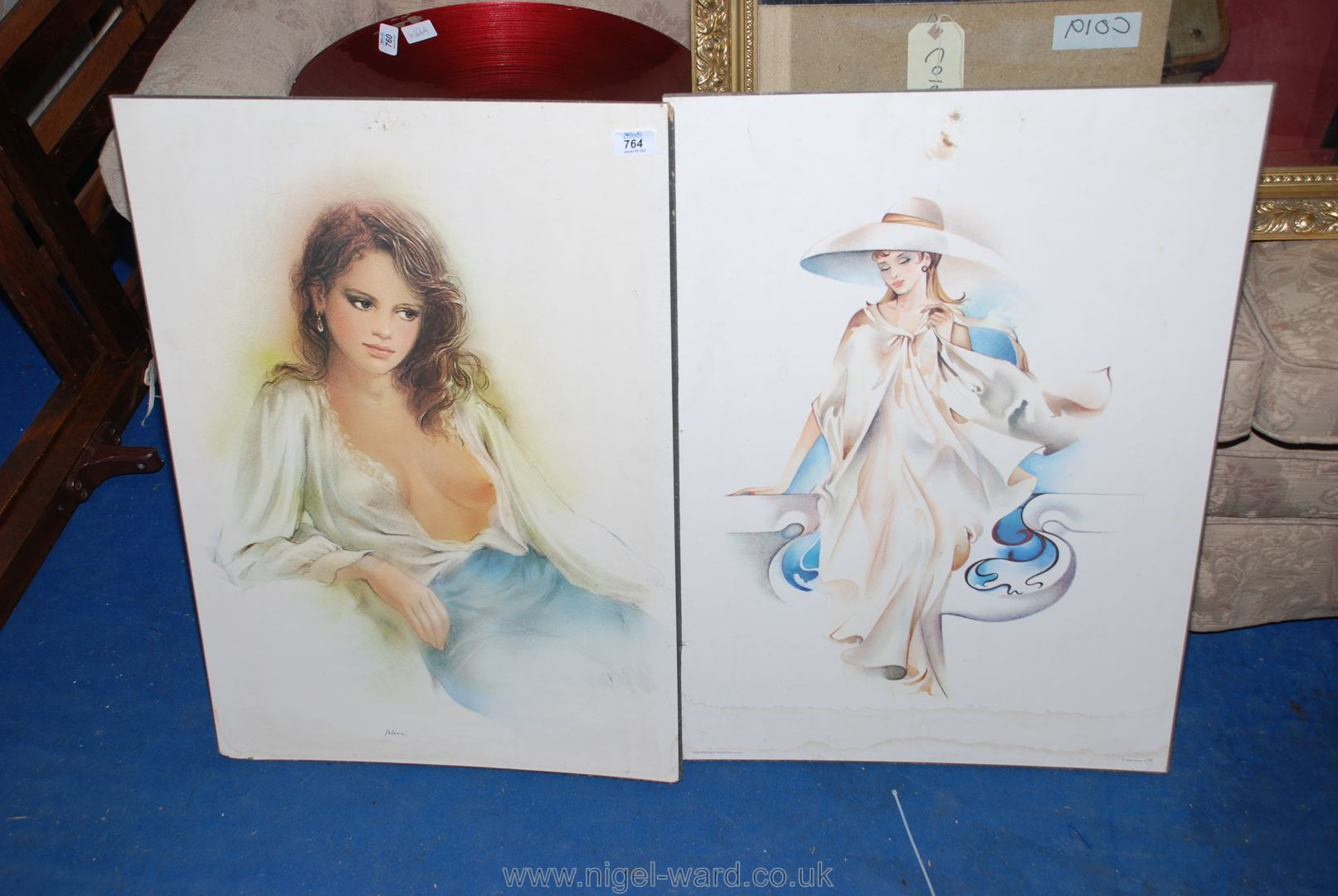 Two large prints on board : Alessandra by Sara and a Lady with a revealing blouse by Blanc.