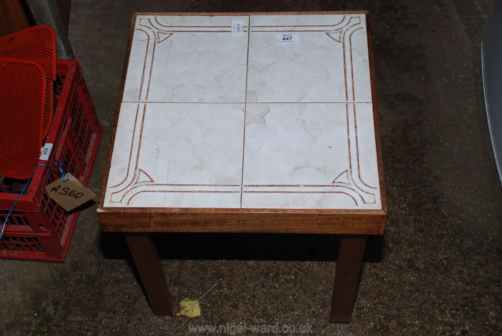 A tiled top occasional table.