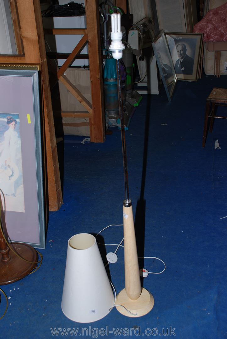 A modern floor lamp with shade a/f.