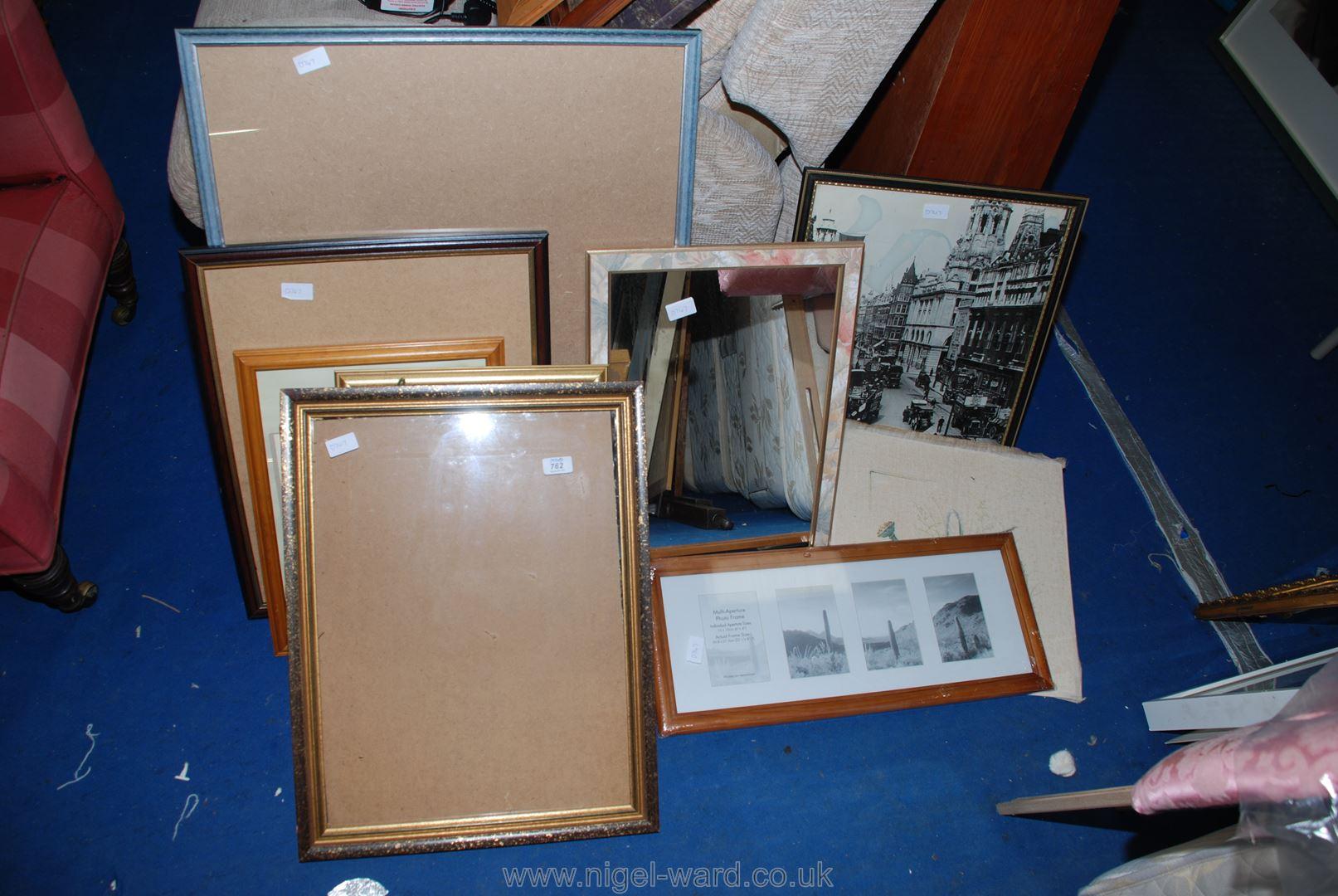 A quantity of glazed frames, photo frames, a mirror and a print, etc.