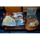 A box of various buttons, sewing accoutrements, etc.