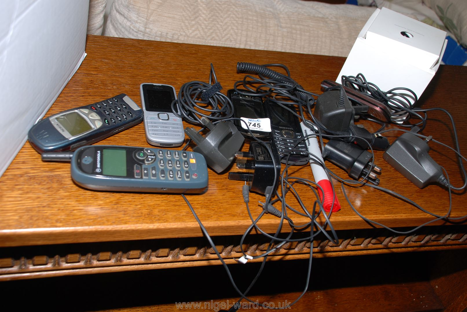 A quantity of various mobile phones, chargers, etc.
