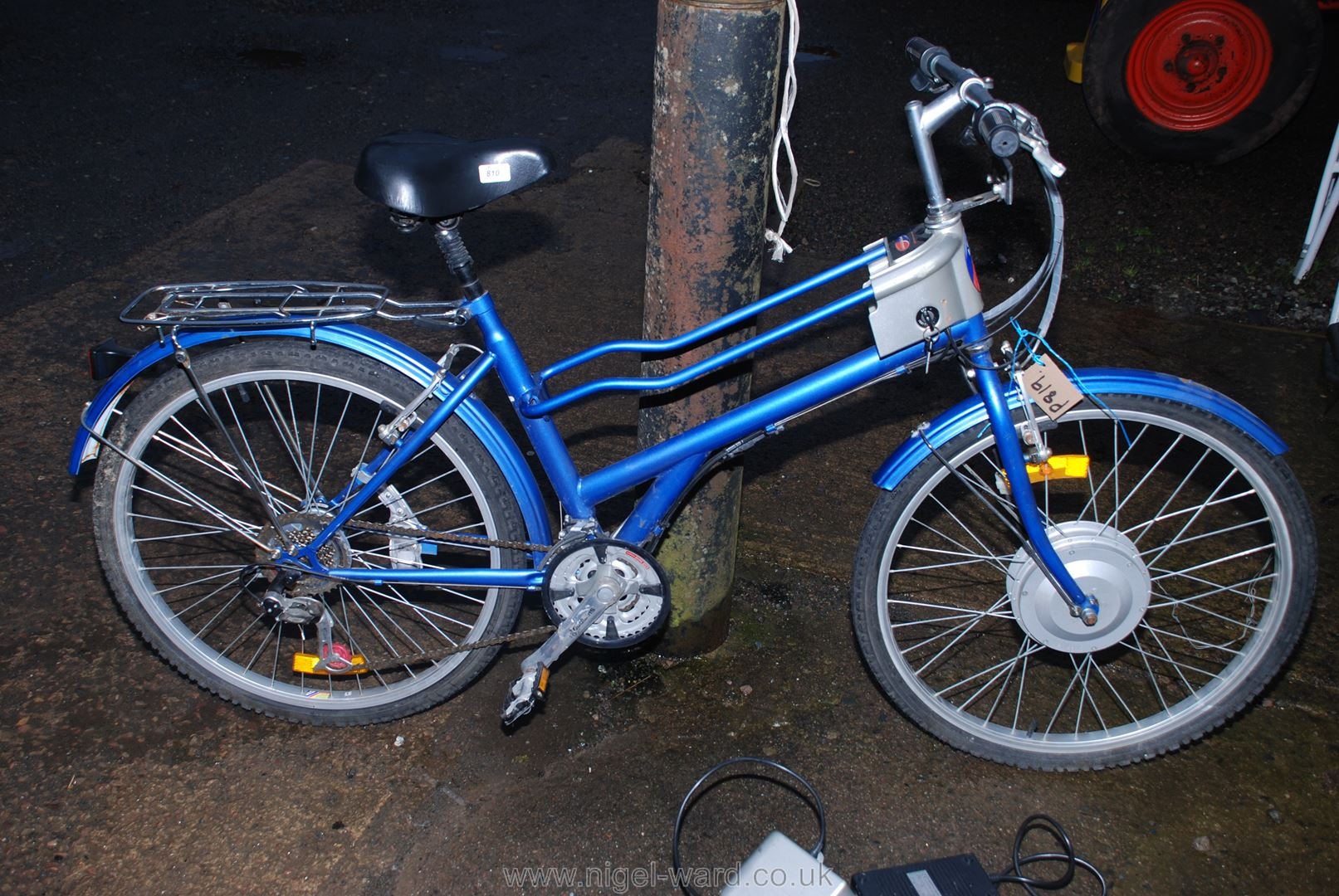 """A 21 Speed """"Powabyke"""" with battery and charger."""