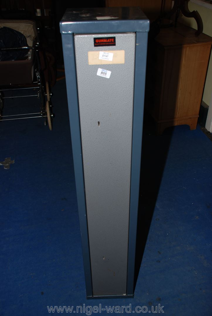 A metal gun-safe for wall attachment, keys in office.