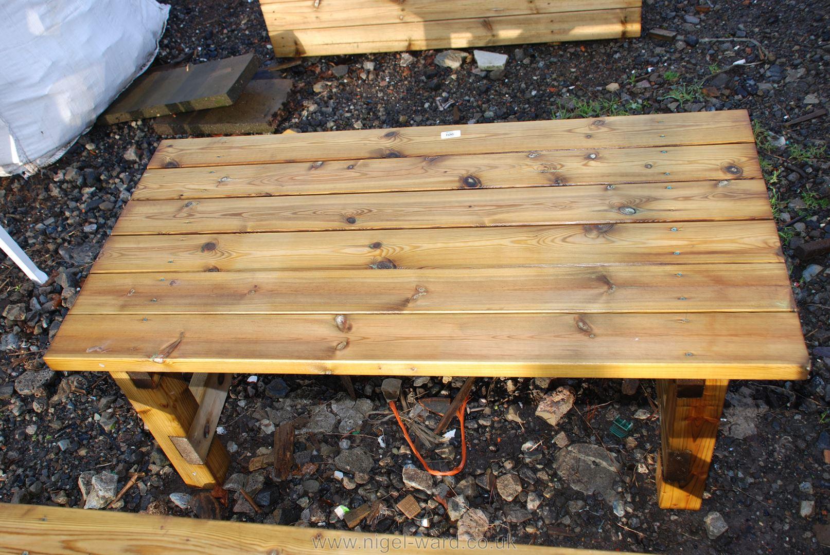 Wooden garden table 46 1/2'' x 23 1/4'' x 17''.