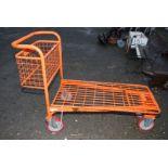 An orange porter's Trolley.