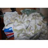 A quantity of curtains, bed linen, fabric, etc.