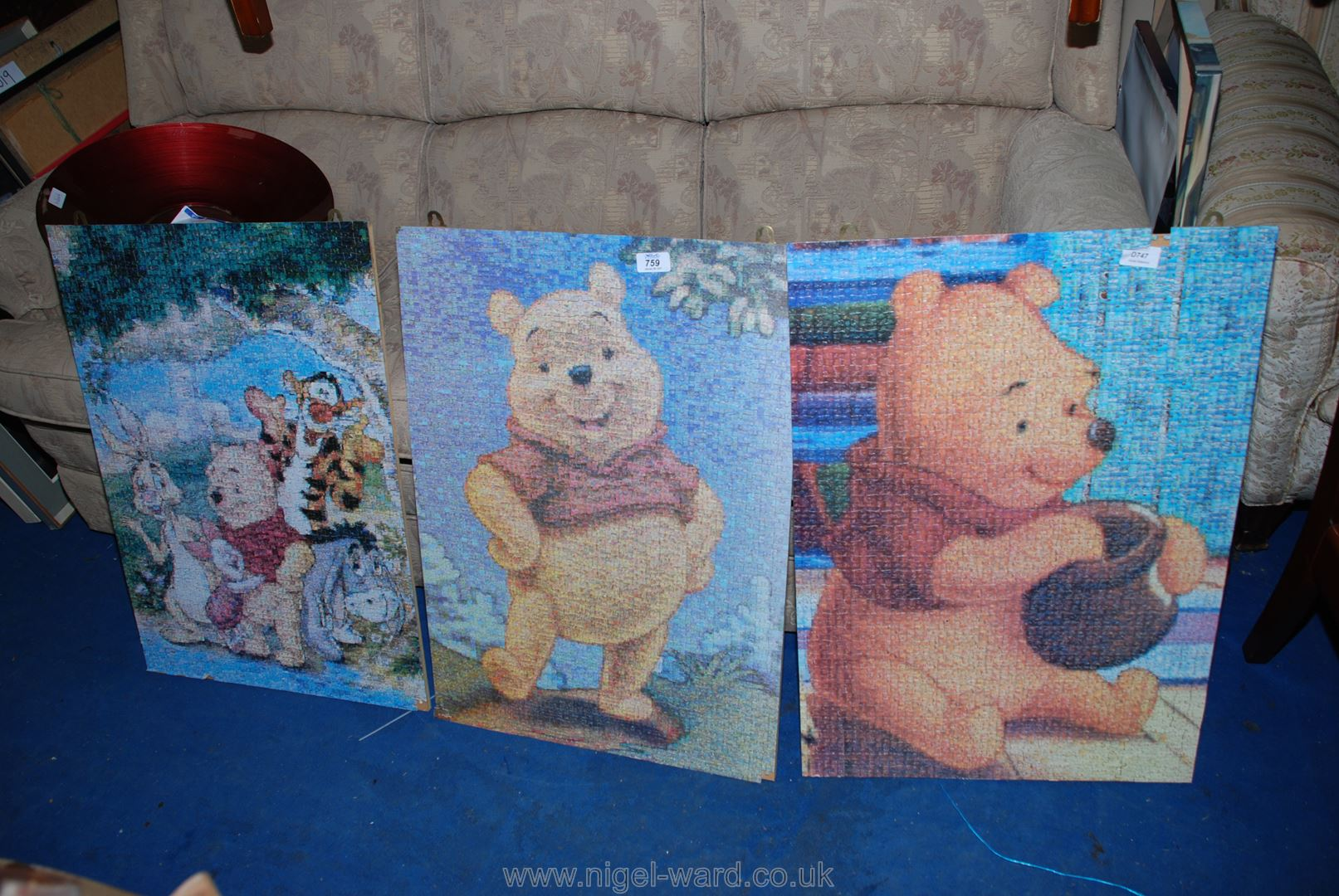 Three jig-saw puzzles assembled, affixed to boards, Winnie the Pooh, etc.