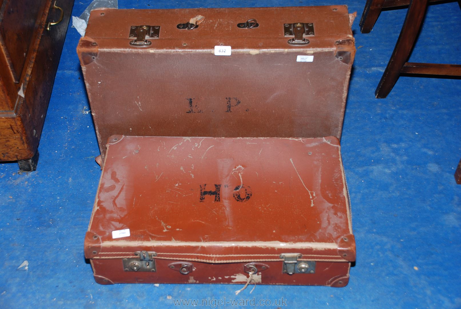 A leather suitcase plus another.