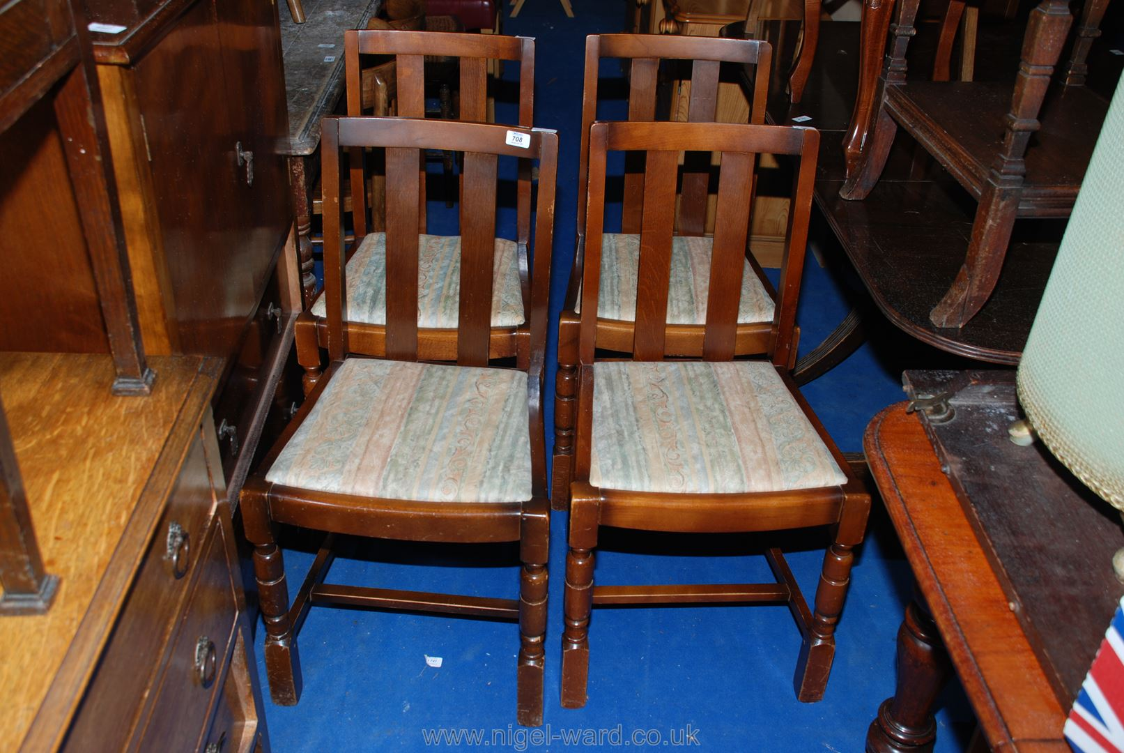 A set of four Oak and other woods dining chairs with drop-in seats.