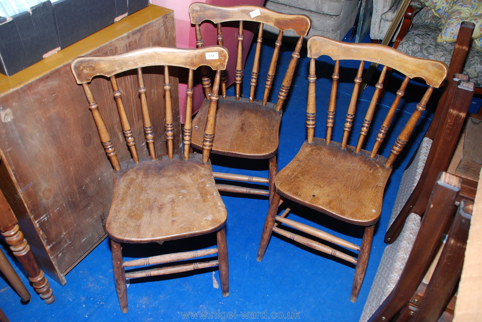 Three solid Elm seated stick-back kitchen chairs with turned back, leg and stretcher details.