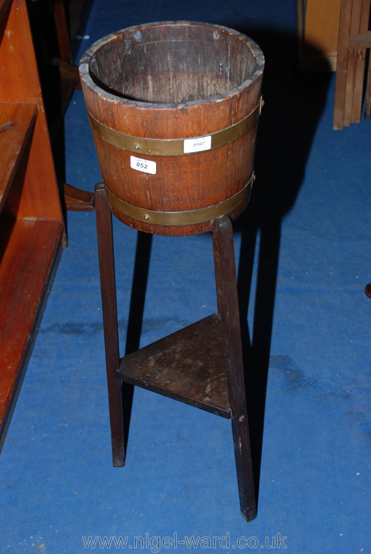 A brass and Oak coopered barrel-style plant stand.