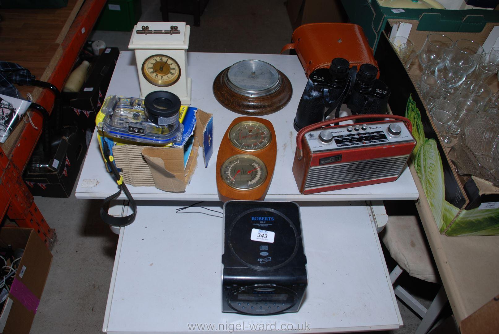 "A pair of 10 x 80 binoculars, clocks, two ""Roberts"" radios, underwater camera housing, etc."