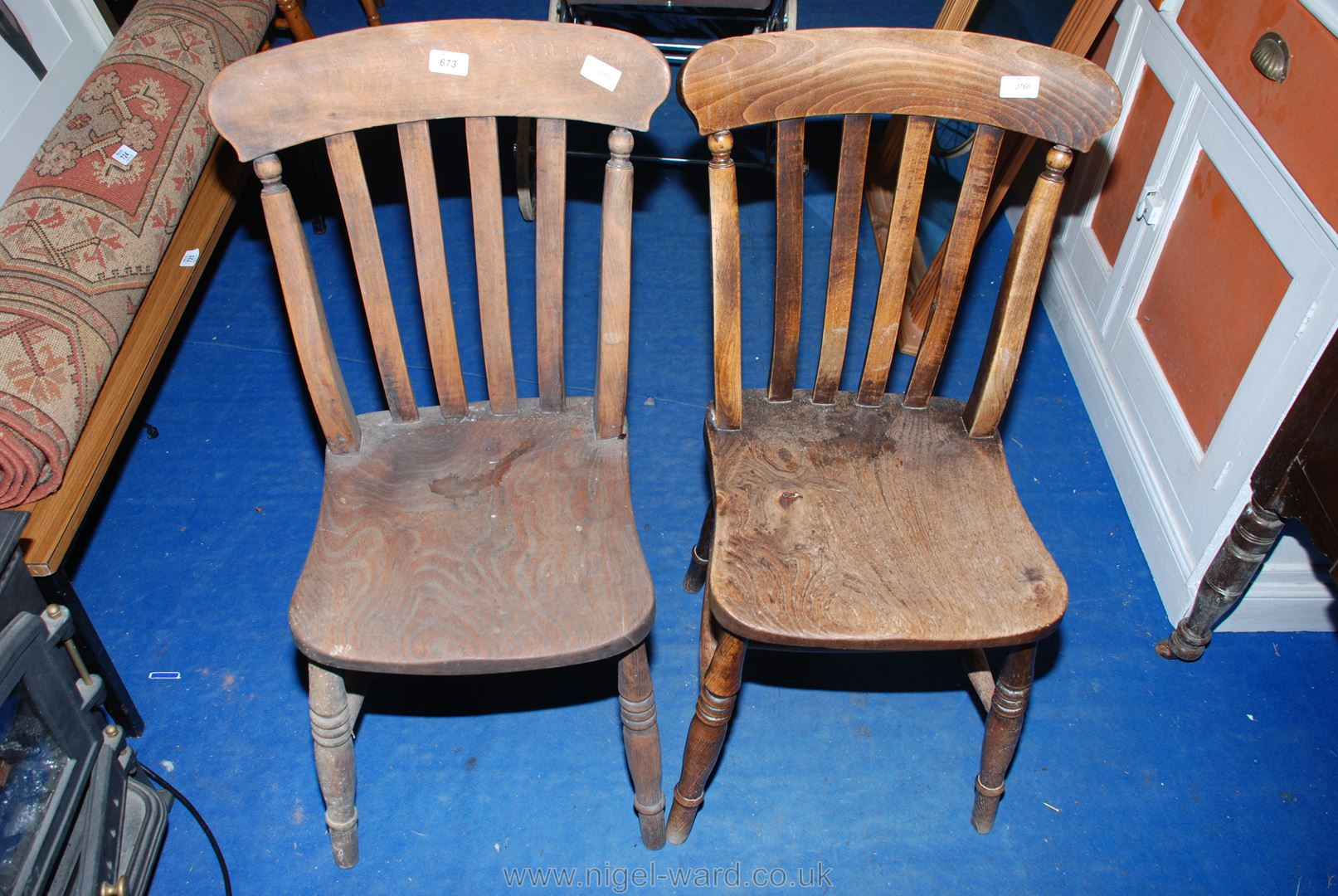 Two Elm-seated kitchen chairs.
