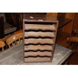"""An old stained-Pine, table-top, six-shelf stationery/music storage unit, 13 1/2"""" x 10"""" x 20"""" high."""