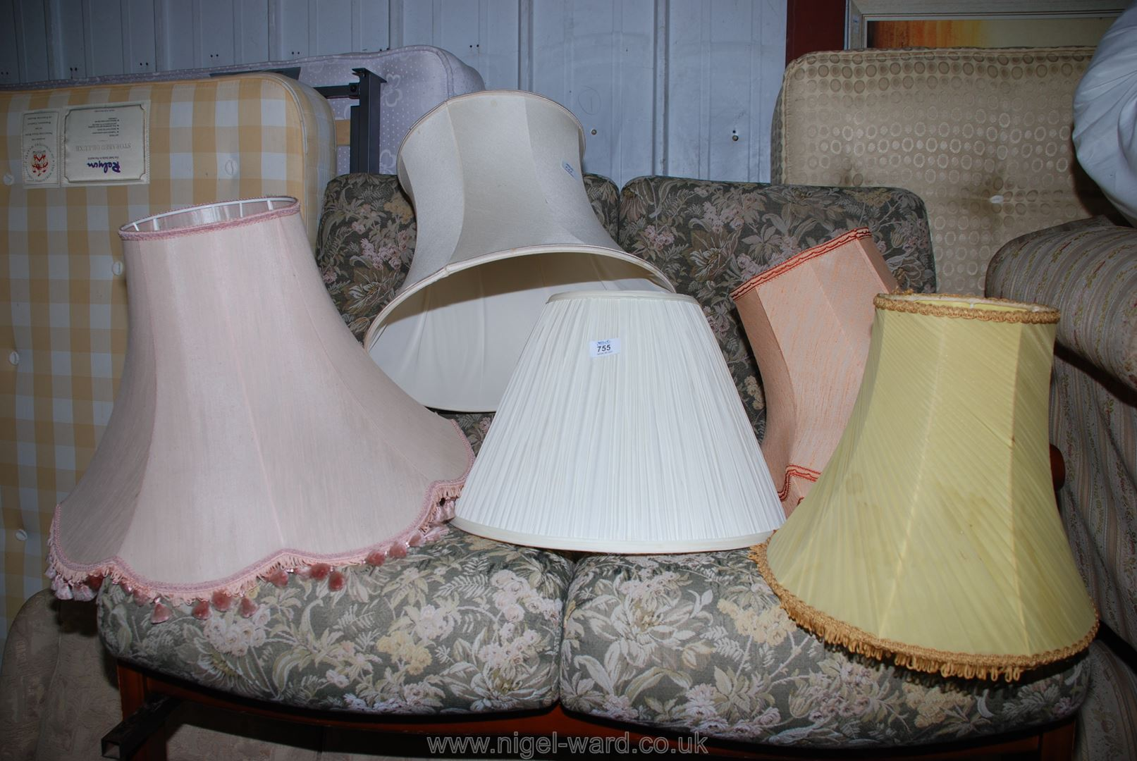 A collection of various linen lamp-shades.
