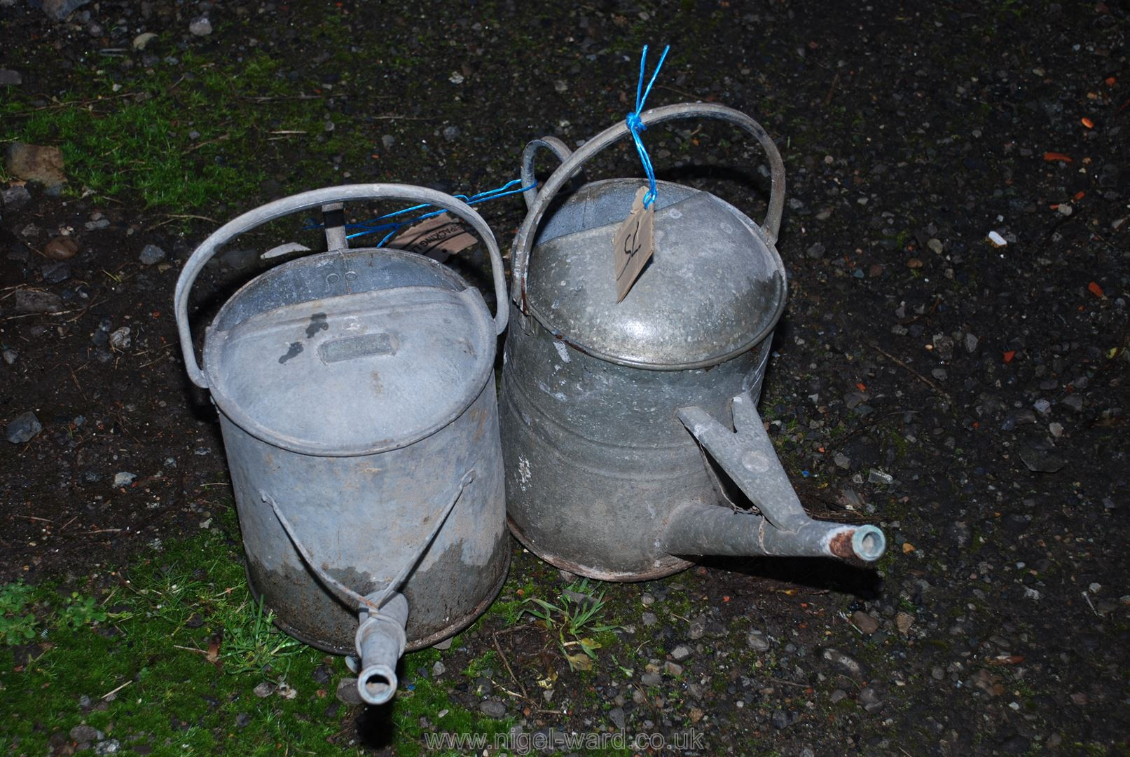 Two galvanised watering cans.