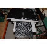 A quantity of wall-hanging screen stencils.