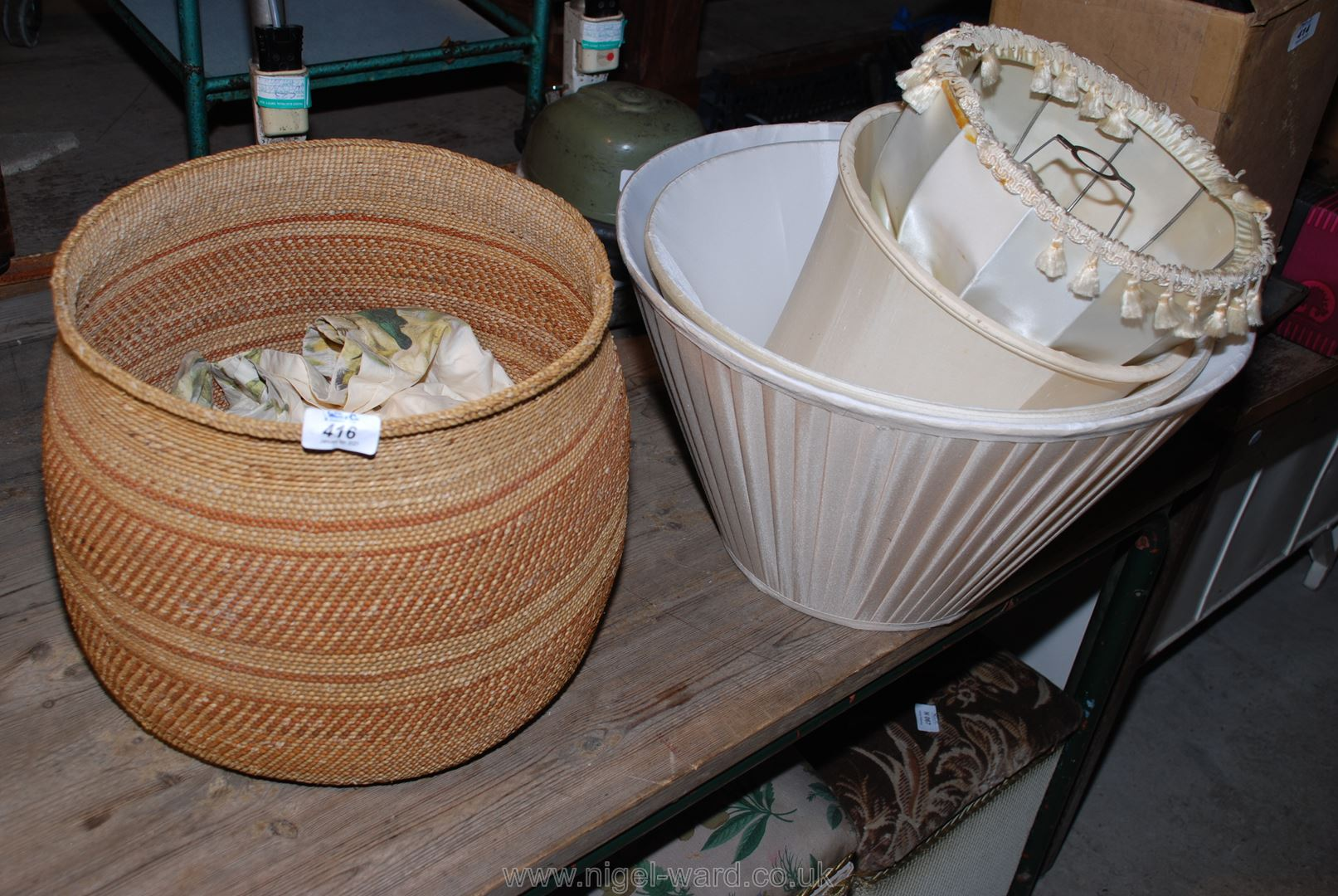 A snake charmer's Basket and quantity of lampshades.