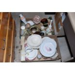 Two boxes of serving dishes, dinner ware, condiment sets, vases, etc.