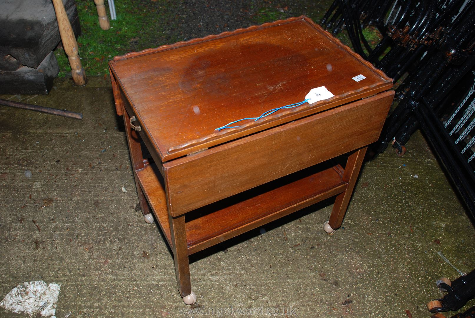 A drop-leaf tea-table with drawer and lower shelf.