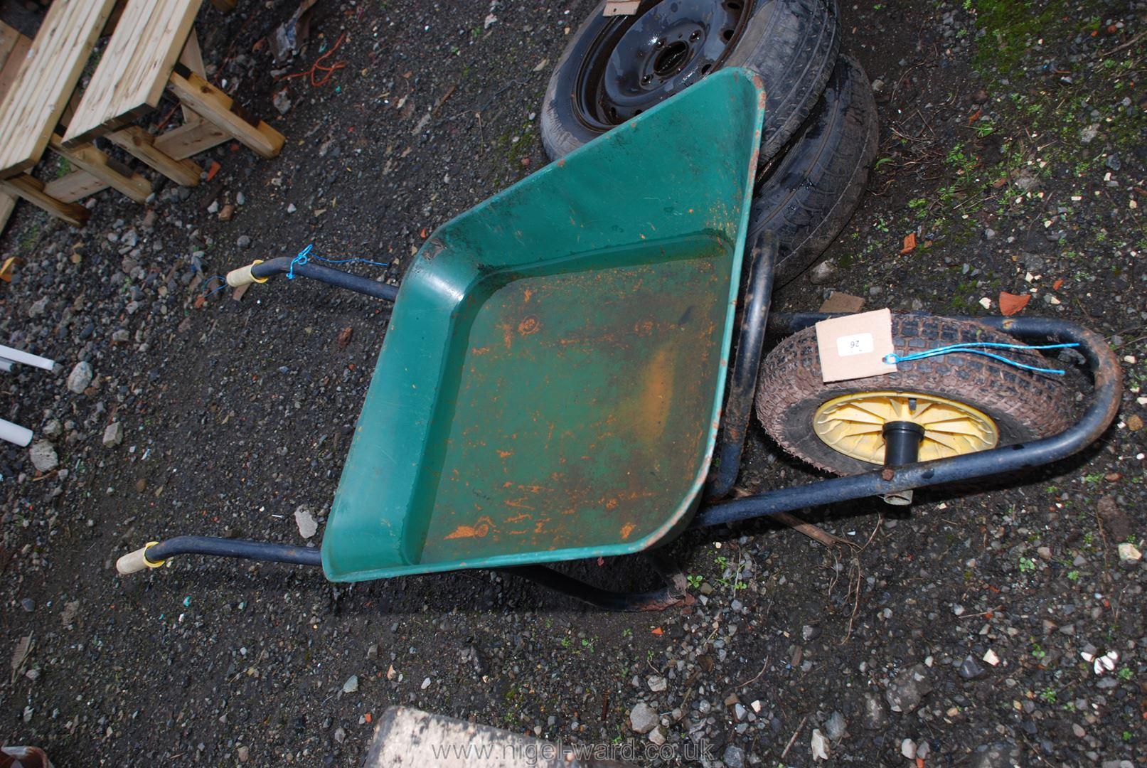 Green wheelbarrow with pneumatic tyre