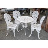 Lightweight cast metal five piece patio set of table and four chairs