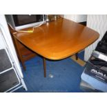 """A Teak finished double gate-leg drop-leaf dining table, 39"""" x 16"""" extending to 70"""" approx."""