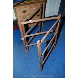 A wooden clothes horse for restoration.